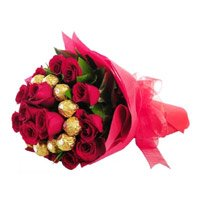 Send Online Rakhi with Chocolate, Red Roses Gift hamper to India