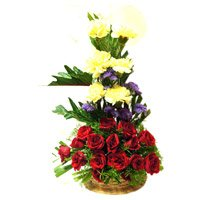 Rakhi with Red Rose Yellow Carnation Basket 30 Flowers to India