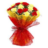 Rakhi with Red Yellow Carnation Flower Bouquet delivery in India