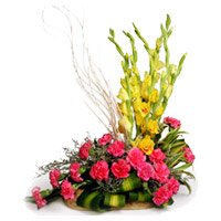 Deliver Online 18 Pink Carnation 6 Yellow Glad Flower Basket with 2 Free Rakhi to India