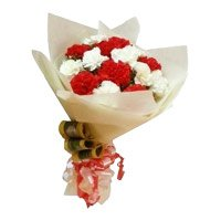Send Rakhi with Red and White Carnation Bouquet 12 Flowers to India