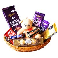 Rakhi Gift  hamper delivery in India incuding of Exotic Chocolate Basket With 6 Inch Teddy