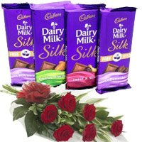 Send 4 Cadbury Dairy Milk Silk Chocolates With 6 Red Roses. Flowers Delivery to Ahmedabad