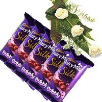 Order 5 Cadbury Silk Bubbly Chocolate With 3 White Roses with rakhi Delivery in India