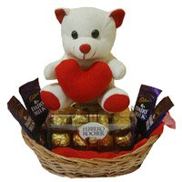 Online Rakhi Gift in India. 4 Dairy Milk 16 Ferrero Rocher Chocolates and 6 Inch Teddy Basket