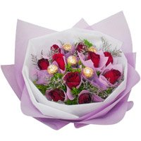 Online Rakhi Gift Delivery of 12 Red Roses 5 Ferrero Rocher Bouquet India