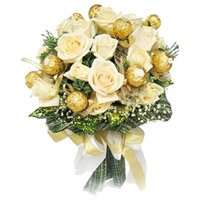 Rakhi hamper Delivery in India Ferrero Rocher with 16 White Roses Bouquet
