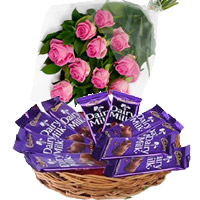 Send Dairy Milk Basket 12 Chocolates With 12 Pink Roses. Gifts Delivery to India