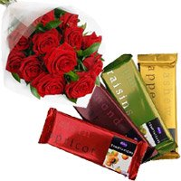 Online Rakhi Gift hamper Cadbury Temptation Bars with 12 Red Roses Bunch and Flowers with Rakhi to India