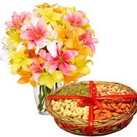 Four Rakhis with Lily Flowers and Mix Dry Fruits Rakhi Gift hamper online
