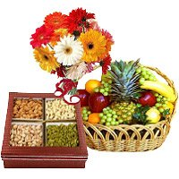 Send 12 Mix Gerbera with 500 gm Mix Dry Fruits with Rakhi Gifts in India and 1 Kg Fresh Fruits Basket