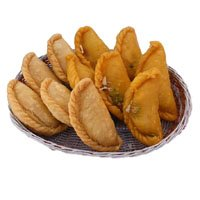 Rakhi Gift Delivery in India with 500 gm Gujiya With 1 Free Rakhi