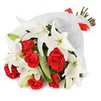 Get Rakhi and White Lily Red Roses Bouquet