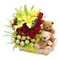 Send Lily, Roses, Chocolate, Small Teddy with Rakhi Gift hamper to India