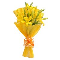 Yellow Lily Flower and Rakhi