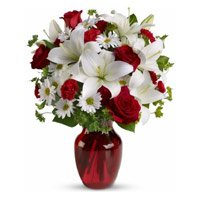 2 White Lily 6 White Gerbera 6 Red Roses Vase and Rakhi Delivery to India