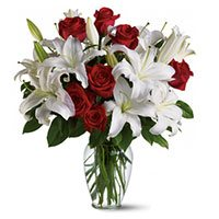 4 White Lily 12 Red Roses Vase with 2 Free Rakhi to India