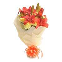Buy Rakhi and Orange Lily 12 Yellow Carnation Flowers in India