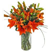Rakhi and Orange Lily Vase Flowers delivery in India for brother