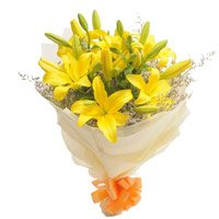 Online Yellow Lily Bouquet Flowers with Rakhi