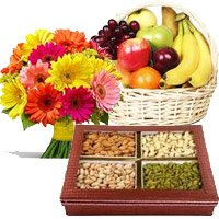 Rakhi Gift hamper for Brother Gerberas, Fresh Fruits and Dry Fruits with Rakhi