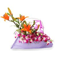 Send Rakhi with 9 Orchids 3 Lily Flower Arrangement to India