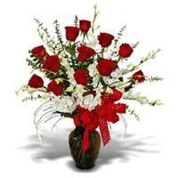 Get Rakhi with 5 White Orchids 12 Red Roses Vase Delivery in India
